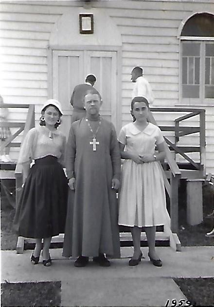 Fr Leonid Upshinsky with two parishioners